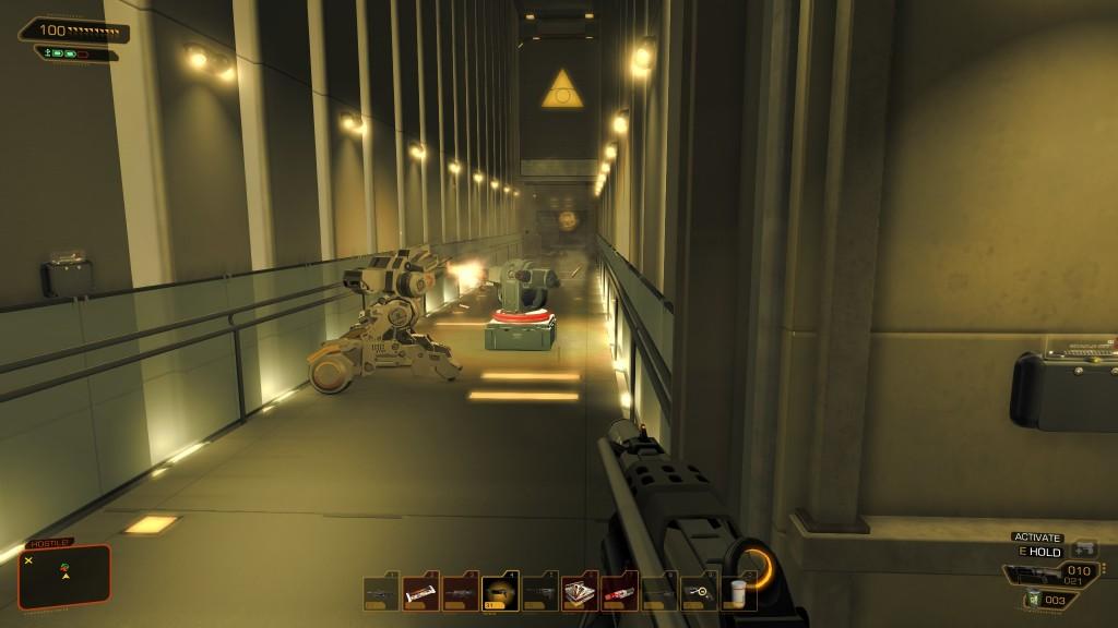 Deus Ex: Human Revolution - A turret battles a guard robot